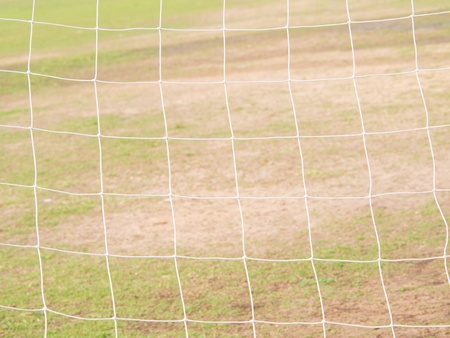 Soccer net with background grass photo