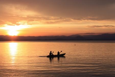 jezior: Obraz figury, Rower na zachodzie słońca