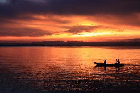Afbeelding van silhouet, Rower bij zonsondergang Stockfoto