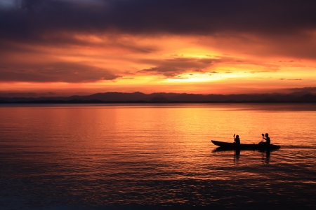 canoe paddle: Image of silhouette, Rower at sunset