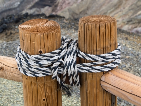 bonding rope: Two parts of a wooden fence tied together by the rope