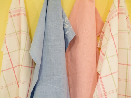tea towel: Group of colorful Tablecloth on hanger at kitchen