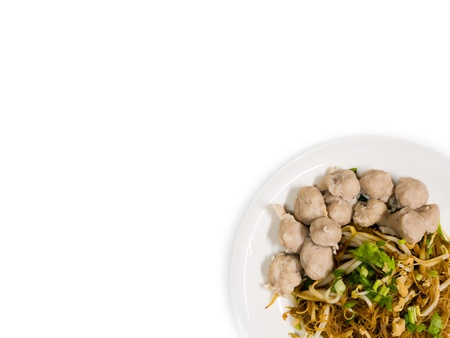 cooked instant noodle: noodle and meatballs isolated on white