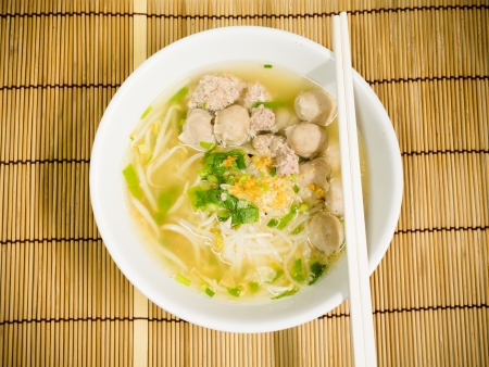 pork meatballs and noodle soup photo