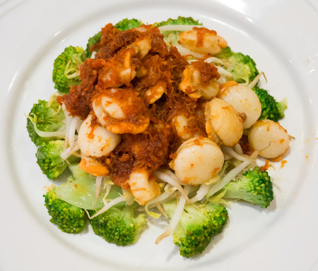 Scallops and broccoli stir fire with spicy sauce Stock Photo
