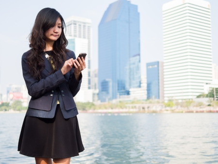 young businesswoman talking on mobile phone photo