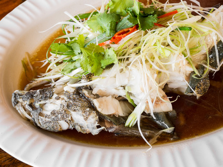Steamed goby fish with soy sauce photo