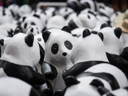 wwf: Bangkok,Thailand - March 15 ,2016 : Flash mob 1600 Pandas World Tour by WWF at Bangkok Railway Station (Hua Lampong). This campaign of WWF to raise awareness in conservation for endangered animals.