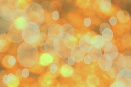 paragraphs: light orange bokeh background
