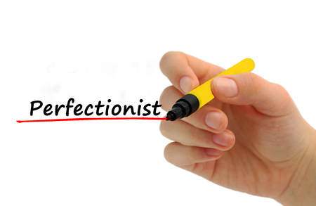 Hand writing Perfectionist with red marker business concept