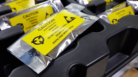 Yellow caution label on ESD bag,Standard caution label with text