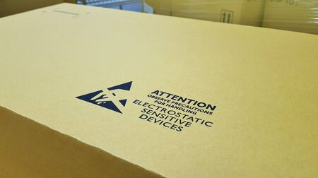 Standard caution Electrostatic Sensitive Device (ESD) symbol on the box,The options for transporting electronic devices. Imagens