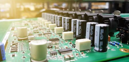Circuit board with electronic components, Piece of electronic equipment such as microchips, capacitors, transistors, resistances and other electronic components mounted on PCB ,PCBA