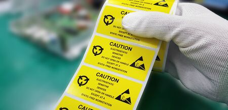 Yellow caution label in electronic industry,CAUTION Electrostatic Sensitive Device for handling in ESD workstation. Standard-Bild