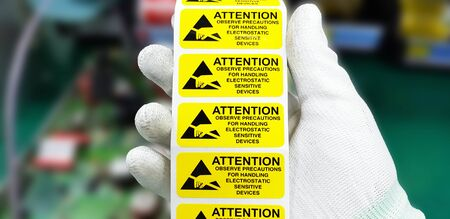 Yellow caution label in electronic industry,CAUTION Electrostatic Sensitive Device for handling in ESD workstation. Banque d'images