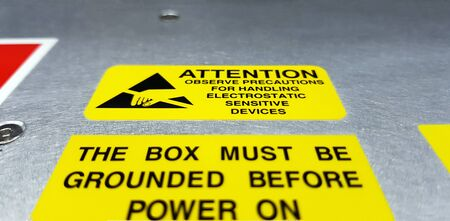 Standard caution label with text for Electrostatic Sensitive Devices (ESD) attached on electronic box,Special label symbol for electrostatic sensitive devices.