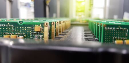 Electronics Manufacturing Services, Assembly Of Circuit Board arrangement, close-up of the raw of PCBA in tray.