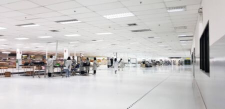 Small warehouse logistic or distribution center in electronic industry. Interior of warehouse with rows of shelves with big boxes.