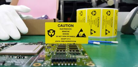 The yellow CAUTION label for Electrostatic Sensitive Devices (ESD) on static free workstation. Banque d'images