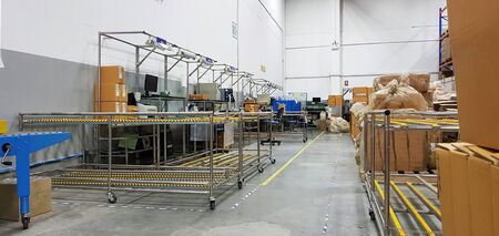 Inside a Printing and Packaging Factory Facility,Packaging department to prepare for delivery to customers, Working area in the shipping department of a company and packs goods into packages for the customer. Banque d'images