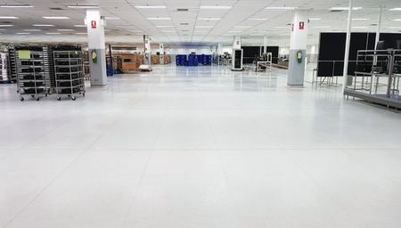 17 June 2019 Pathumthani Thailand : Factory for the manufacture of electronic printed circuit boards,Line production and mini warehouse with rows of shelves with boxes.