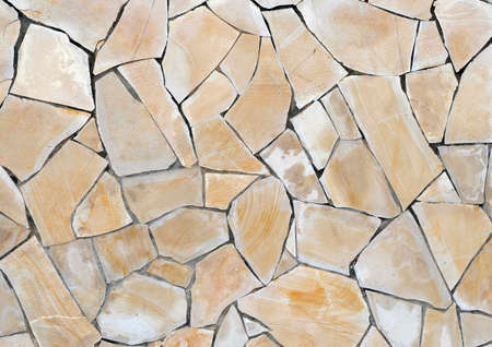 The texture of the stone wall as a background or texture.