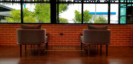 Social distance concept. keep spaced between each chairs make separate for social distancing, increasing physical space between people to avoid spreading illness during transmission of COVID-19 免版税图像