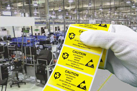 Hand holding ESD symbol label with antistatic gloves on black background,Electrostatic Sensitive Devices (ESD) in electronic industrial. Banque d'images