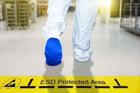 Hand holding ESD symbol label with antistatic gloves on black background,Electrostatic Sensitive Devices (ESD) in electronic industrial.