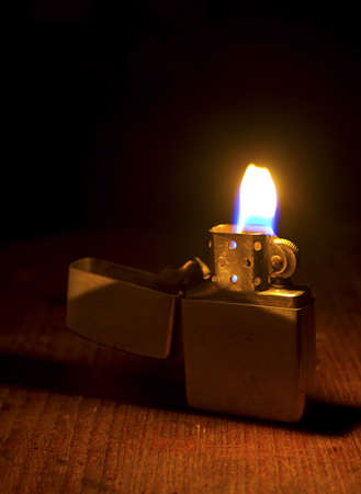 Burning lighter on dark background