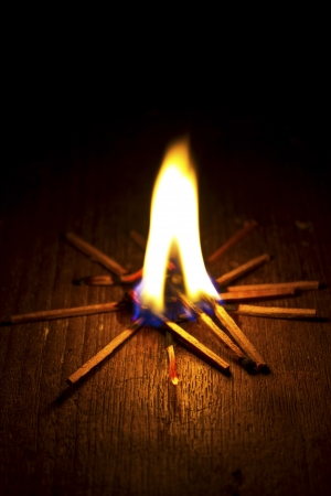 Burning match on a black background photo