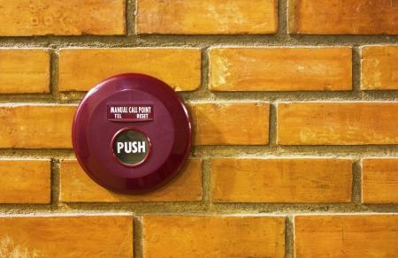 fire alarm on brick wall photo