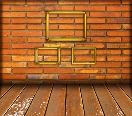 Gold frame on old red brick wall Stock Photo