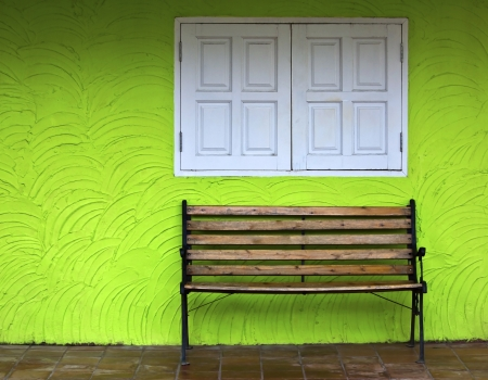 Wood chair on green wall background photo