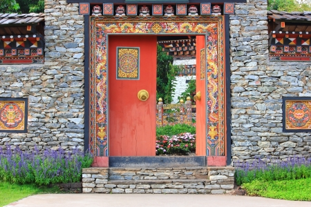 Bhutan style door and wall entrance photo