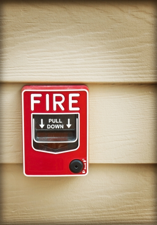 fire alarm on wood wall background photo