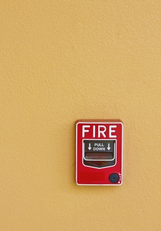 fire alarm on wall background photo