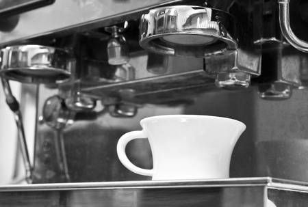Coffee cup on the coffee machine  photo