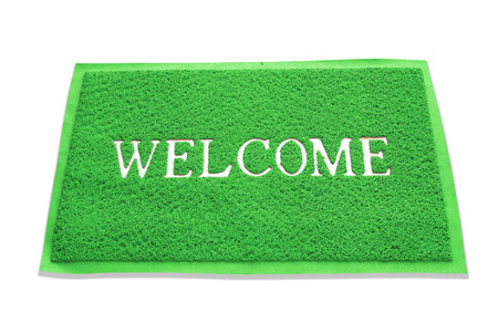 The doormat of welcome text on white background photo