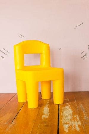yellow plastic chair photo