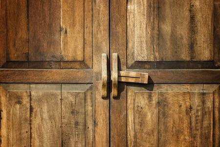 Old wood door with unlock in Thailand photo