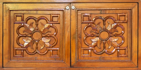 Wooden carved wardrobe doors closeup photo