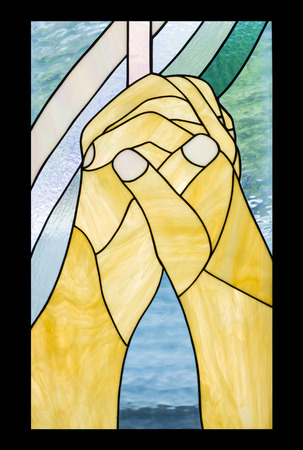 praying hand, cross in stained glass style photo