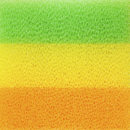 Closeup colour sponges for dishwashing, abstract background photo