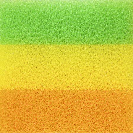 dishwashing: Esponjas de colores Primer plano para lavar platos, fondo abstracto