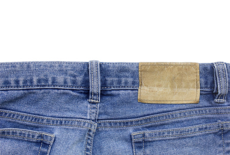 Jeans texture with leather label isolated photo