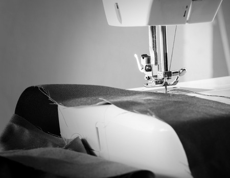 sewing machine working part with cloth Stock Photo