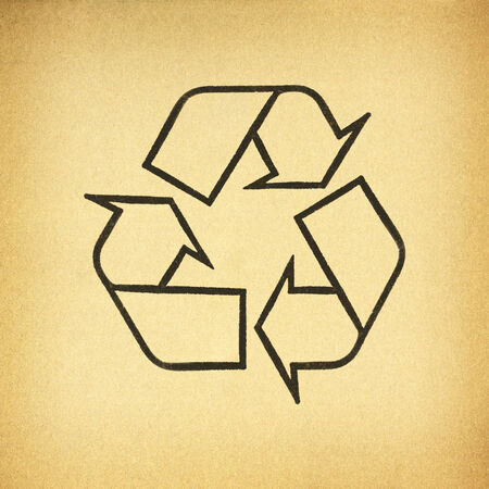 Cardboard box background with recycle symbol photo
