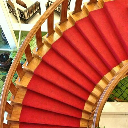 Red carpet on wood stairs