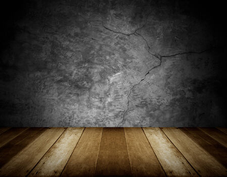 wooden floor and cracked stone wall background photo
